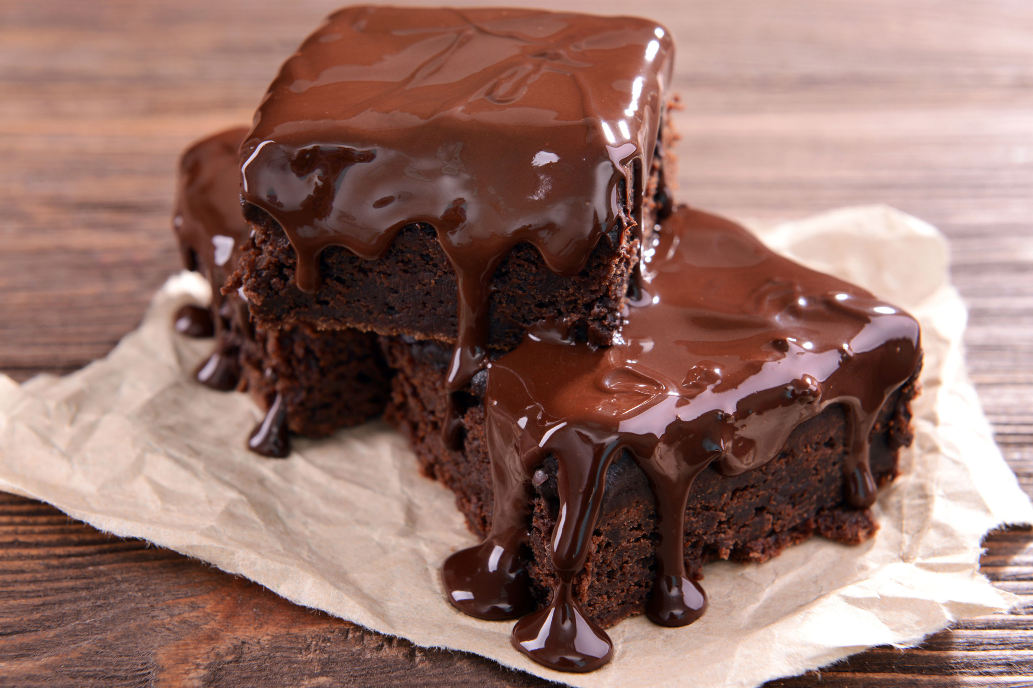 Delicious chocolate cakes on table close-up